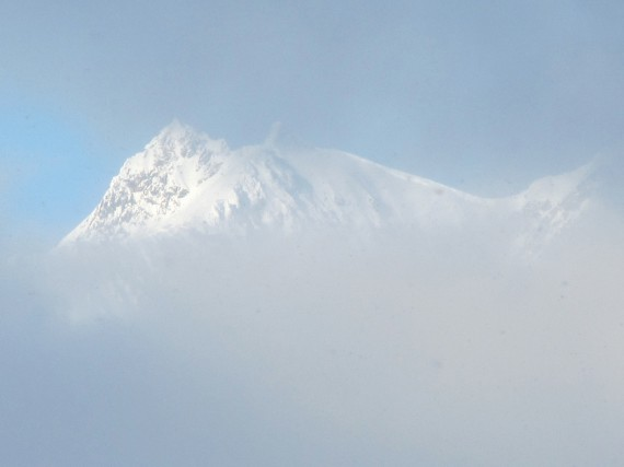 Mountain peaking out through the clouds